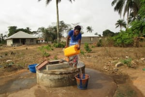 The Water Project: Kasongha Community, Kombrai Road -  Filling Containers With Water