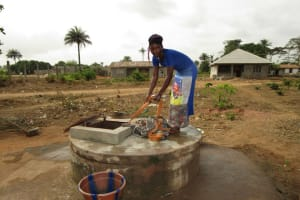 The Water Project: Kasongha Community, Kombrai Road -  Pulling Bucket Of Water Up Well
