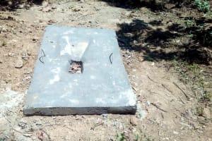 The Water Project: Shilakaya Community, Shanamwevo Spring -  Example Of A Dry Sanitation Platform