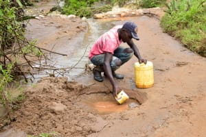 The Water Project: Mbakoni Community A -  Fetching Water