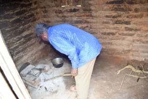 The Water Project: Kivandini Community -  Mr Mbithi Showing Us His Kitchen