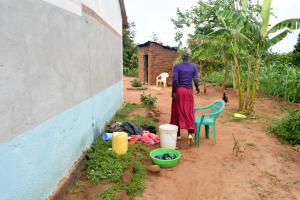 The Water Project: Kivandini Community A -  Mbithi Water Containers