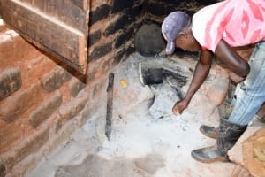 The Water Project: Mbakoni Community A -  Showing Us How A Meal Is Cooked