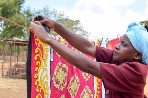 The Water Project: Mbau Community -  Using A Clothesline