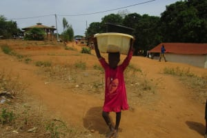 The Water Project: Targrin Community -  Carrying Water