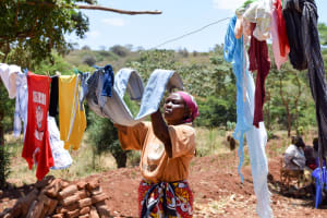 The Water Project: Utuneni Community A -  Esther Using A Clothesline