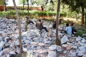 The Water Project: Kaani Lions Secondary School -  Breaking Up Stones For Tank Construction