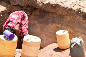 The Water Project: Utuneni Community C -  Getting Scoop Hole Water