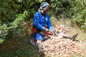 The Water Project: Kitandini Community -  Breaking Up Stones