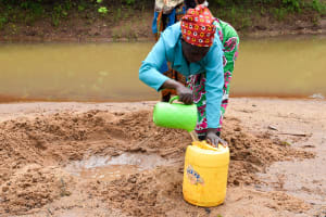 The Water Project: Kitandini Community -  Fetching Water