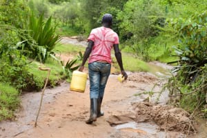 The Water Project: Mbakoni Community -  Carrying Water