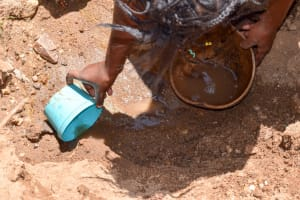 The Water Project: Uthunga Community -  Scooping Dirty Water