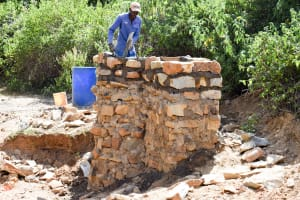 The Water Project: Kitandini Community A -  Artisan Putting The Finishing Touches On The Well