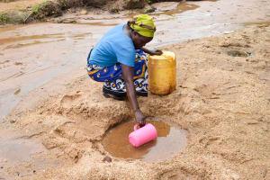 The Water Project: Kivandini Community -  Fetching Water