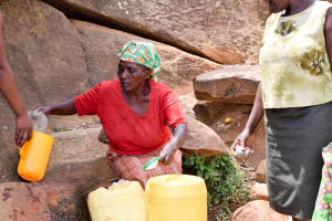 The Water Project: Uthunga Community -  Filtering Water Before Pouring It In Jerrycans