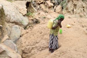 The Water Project: Mbau Community A -  Carrying Water