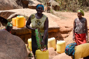 The Water Project: Utuneni Community -  Carrying Heavy Container