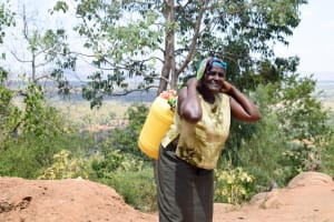 The Water Project: Uthunga Community -  Carrying Heavy Water