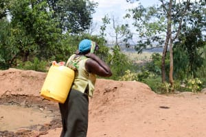 The Water Project: Uthunga Community A -  Carrying Heavy Water