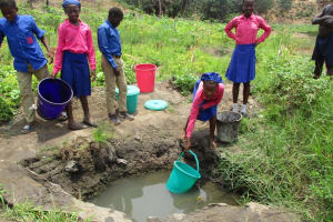 The Water Project: St. John RC Primary School -  Students Fetching Water