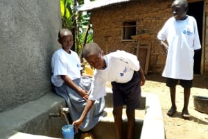 The Water Project: Imuliru Primary School -  Collecting Water From New Tank