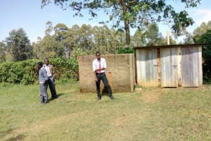 The Water Project: St. John Cheptech Secondary School -  Students Stand In Front Of Latrines