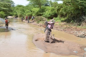 The Water Project: Kala Community -  Lifting Water To Carry Home