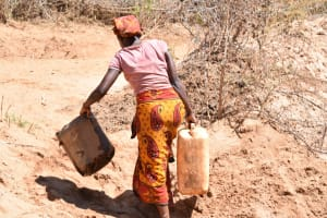 The Water Project: Ngitini Community C -  Carrying Containers To Collect Water