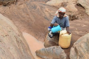 The Water Project: Ikuusya Community -  Pouring Water Into Jerrican