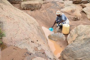 The Water Project: Ikuusya Community -  Scooping Water For Collection