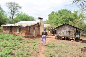 The Water Project: Ikuusya Community -  Walking Into Compound