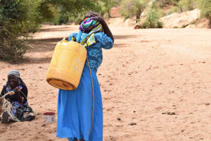 The Water Project: Katalwa Community -  Hauling Water Home