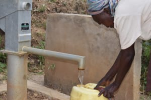 The Water Project: Masaani Community -  Filling Water At First Well