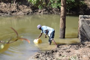 The Water Project: Ilinge Community D -  Fetching Water From Source