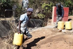 The Water Project: Ilinge Community D -  Hauling Water Home