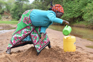 The Water Project: Kaliani Community -  Filling Jerrican With Water