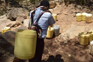The Water Project: Mitini Community B -  Carrying Water Homejpg