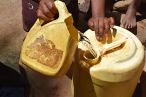 The Water Project: Mitini Community B -  Filling Jerrican With Water