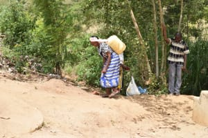 The Water Project: Kithumba Community B -  Carrying Water
