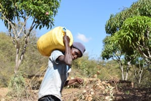 The Water Project: Ilinge Community E -  Hauling Water Home