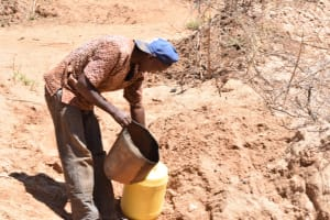 The Water Project: Ngitini Community A -  Pouring Water Into Jerrican