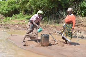 The Water Project: Kala Community A -  Scooping Water And Pouring Into Larger Container