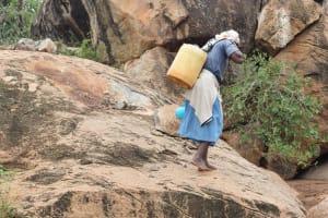 The Water Project: Ikuusya Community A -  Hauling Water Back Home
