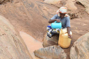 The Water Project: Ikuusya Community A -  Pouring Water Into Jerrican