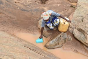 The Water Project: Kathamba ngii Community C -  Scooping Water