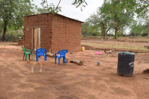 The Water Project: Ikuusya Community A -  Water Storage Container And Chairs In Compound