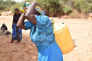 The Water Project: Katalwa Community A -  Hoisting Water To Carry Home