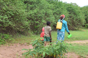 The Water Project: Kaliani Community A -  Walking Home With Water