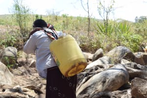 The Water Project: Mitini Community C -  Carrying Water