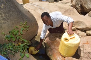 The Water Project: Mitini Community C -  Filling Jerrican With Water